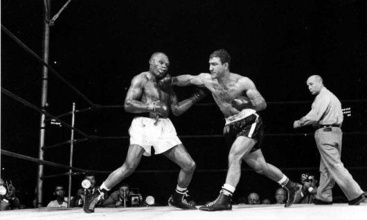 Rocky Marciano lands a Suzie Q on Jersey Joe Walcott