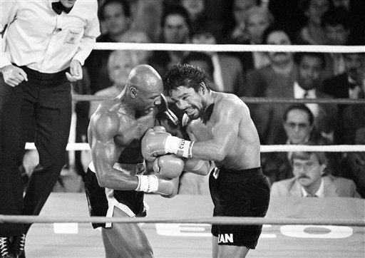 """Marvelous"" Marvin Hagler, connects with a blow to Roberto Duran, right,"