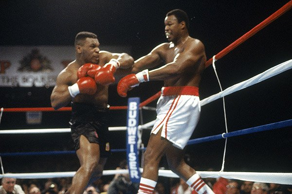 As soon as Holmes fell backward onto the canvas, Cortez waved an end to the bout