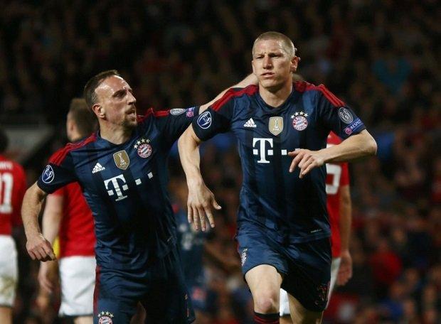 Bastian Schweinsteiger celebrates his goal to make it 1-1