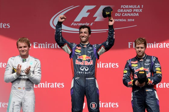 Daniel Ricciardo aloft the top step - claiming his first F1 victory