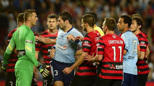 Sydney Fc defender Sasa Ognenovski (Left) and Sydney Fc captain Alex Brosque (Right) in a corner dispute against the Wanderers in their 3-2 win
