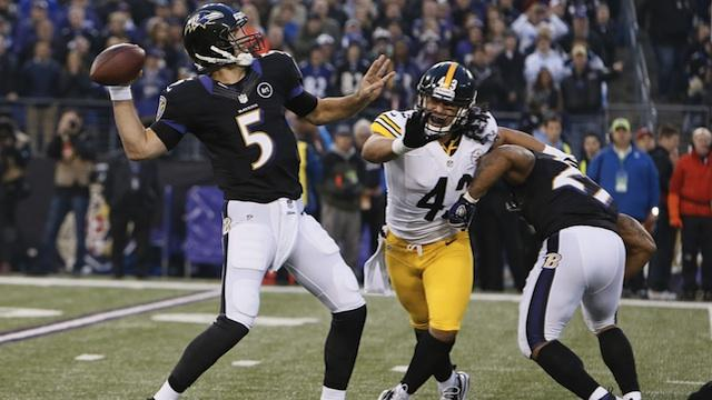 Pittsburgh Steelers Safety Troy Polamalu (43) rushing Baltimore Ravens Quarterback Joe Flacco (5)