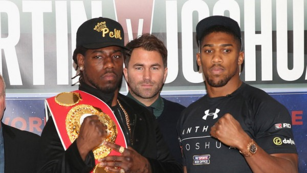 Anthony Joshua (right) will try to take the IBF world title from Martin