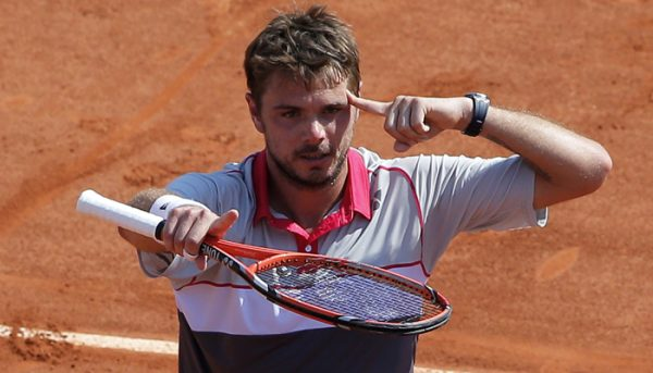 Switzerland's Stan Wawrinka reacts after defeating France's Jo-Wilfried Tsonga during their semifinal match of the French Open tennis tournament at the Roland Garros stadium, Friday, June 5, 2015 in Paris. Wawrinka won 6-3, 6-7, 7-6, 6-4. (AP Photo/Christophe Ena)