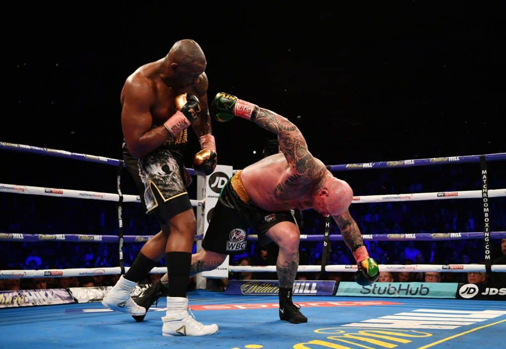 Dillian Whyte floors Lucas Browne, sending him to the canvas to get the KO win.