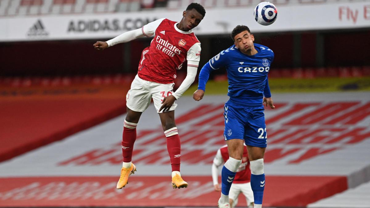 Eddie Nketiah challenges Ben Godfrey in the air.