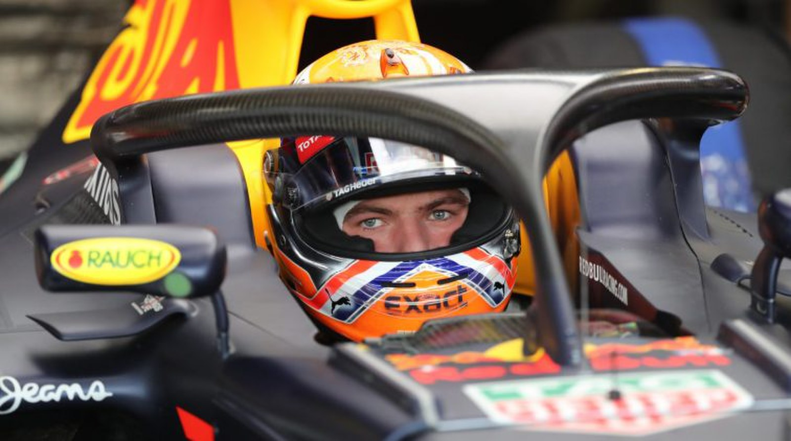 Max Verstappen sitting in his Red Bull car