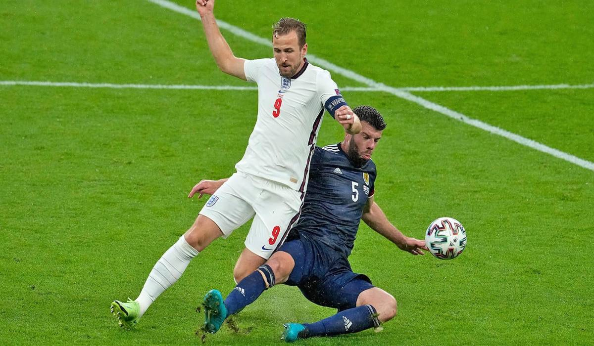 Grant Hanley Battling Harry Kane To Nudge The Ball Away From The England Captain