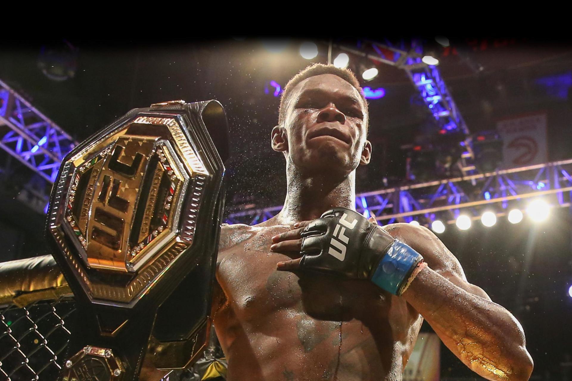 UFC 263 - Israel Adesanya with belt