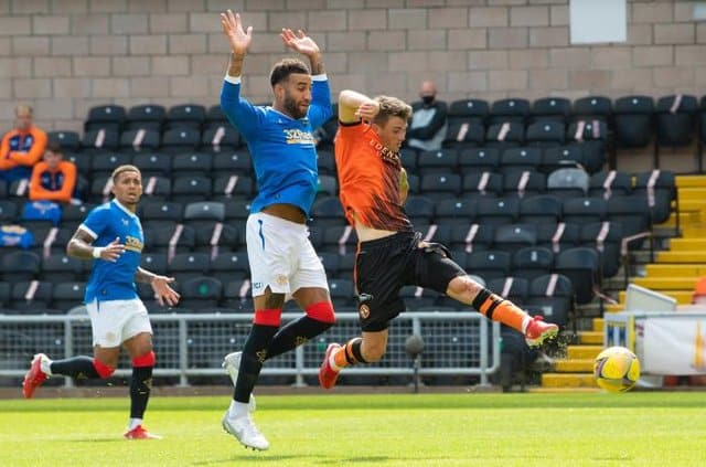 Robson slots it past the goalkeeper as Rangers defenders, Tavernier and Goldson watch on.
