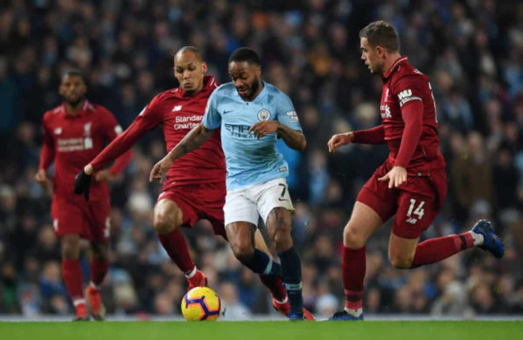 Manchester, England - January 03: Raheem Sterling Of Manchester City Is Challenged By Fabinho Of Liverpool And Jordan Henderson Of Liverpool During The Premier League Match Between Manchester City And Liverpool Fc At The Etihad Stadium On January 3, 2019 In Manchester, United Kingdom.  (Photo By Shaun Botterill/Getty Images)